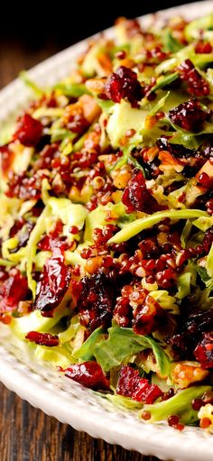 Warm Quinoa and Brussels Sprout Salad in Honey Mustard Vinaigrette is loaded with pecans and cranberries. Healthy salad, lots of nutrients, antioxidants, red quinoa, Dijon mustard, gluten free #healthy #veggies #healthysalads