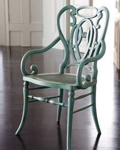 Green Scroll Armchair by Horchow $799.  I think the color is great and love the back. Gotta have at least 2 for the breakfast table