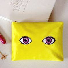 NIB  Charlotte Olympia 'Glance A Lot' Absolutely fabulous! This beautiful and fun Charlotte Olympia clutch needs a new home..Brand new in box w/ duster. 'At A Glance' silk/satin clutch will be the talk of the town! Perfect size for a date night or a girls night out. Own a true designer piece !!! Color is neon yellow. 6.5X9X1.5. Perfect condition. Never used. Always kept in box.                                                                                                    NO PP NO TRADES…