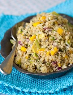 TROPICAL QUINOA SALAD 2 cups quinoa, rinsed and drained 1 mango, peel removed and diced 1 avocado, peel removed and diced 1/2 red onion, diced 1/4 cup shredded coconut Juice of 2 limes 3 Tbsp coconut or olive oil kosher salt black pepper