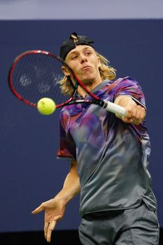 Canada's Denis Shapovalov returns the ball to Spain's Pablo Carreno Busta in their Qualifying Men's Singles match at the 2017 US Open Tennis Tournament on September 3rd, 2017 in New York. / AFP PHOTO / Eduardo MUNOZ ALVAREZ