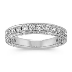 This exquisite band will have you looking at every angle to see every pavé-set diamond from the top and side to side. Surrounding the 88 round diamonds, at Diamond Wedding Rings, Diamond Rings, Diamond Jewelry, Wedding Bands, Jewelry Rings, Bridal Bands, Wedding Dress, Gold Jewellery, Wedding Things