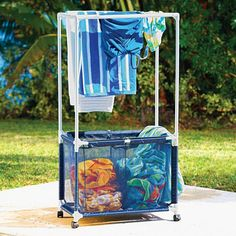 "Swimming Pool Towel Bar/Hamper – links to a web site to purchase. Not a ""how to… - pool towel Pool Float Storage, Pool Toy Storage, Towel Rack Pool, Towel Racks, Pool Organization, Portable Spa, Diy Pool, Pool Fun, Pool Games"