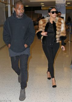 Kim Kardashian wraps up in fluffy coat as she and Kanye West jet out of New York   Daily Mail Online