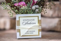 woodgrain place card with gold foil on a favor box filled with luscious flowers http://www.theeventessentials.com/