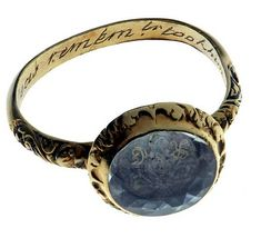 """A woman's """"memorial poesy ring"""" from 1592, made of gold and rock crystal. On the ring's inner surface is inscribed, """"The cruel seas, remember, took him in November."""""""