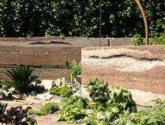 The gold medal winning Mars garden by Sarah Eberle used rammed earth walls at Chelsea 2007.