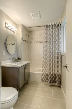 Contemporary Full Bathroom with Oval Ceramic Undermount Bathroom Sink in Biscuit by Ronbow, Winstead Cabinets