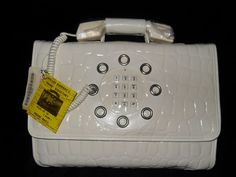 working telephone handbag, 1970s The first cell phone...