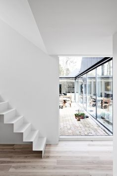 #contemporary #interior #architecture folded #metal #stair #roof #sloped #ceiling #frameless #view #city #garden #white #wood #floor #misch_MISCHltd