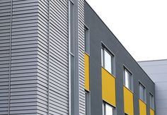Benchmark by Kingspan | Karrier Engineered Facade System | Wall | Facade | Design | Architecture | Yellow | Grey | Texture |