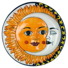Talavera Sun & Moon Wall Hanging is sure to brighten up any room of your home. This colorful piece captures the beauty and skill of the traditional Talavera pottery style. Hand crafted and hand painted in Mexico. $64.00