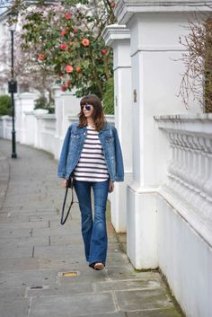 EJSTYLE-Emma-Hill-Double-denim-Spring-outfit-flare-jeans-stripe-HM-top-HM-denim-jacket-navy-bag-nude-sandals-OOTD-street-style-polarised-ray-bans.jpg 1,068×1,600 pixels