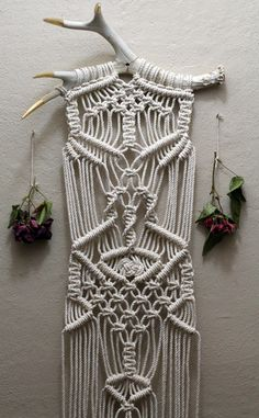 Macramé wall hanging on gold tipped deer antlers