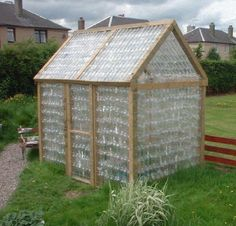 Love this greenhouse made from plastic bottles recycling / reusing rocks!
