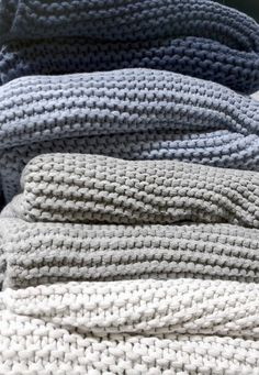 Knitted blankets.....perfect to curl up under with a good book, or your unfinished knitting :)