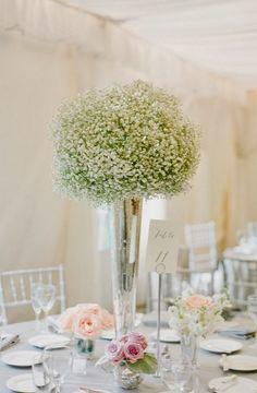 Baby's breath on tall silver vase ~ Jodi Miller Photography // Florist: Julies Floral Design ~ 12 Stunning #Wedding #Centerpieces  | http://www.bellethemagazine.com/2013/12/25-stunning-wedding-centerpieces-part-22.html