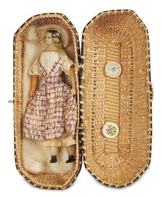 """~1865. 5"""" wax doll in original basket. (I probably would have tried to melt a wax doll.)"""