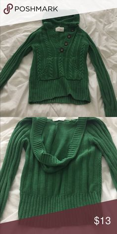 Green sweater Fabric: cotton and acrylic. Good condition. Stretchy but form fitting type of sweater. Button design (buttons actually work) with pocket in front. Sleeve are about 25 inches. Length of sweater is about 21.5 inches. Chest is about 30 inches all around. Aeropostale Sweaters V-Necks