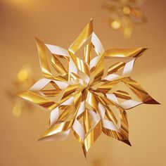 Wrapping Paper Stars- just whipped one of these up at my desk. Easy!