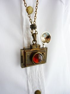 Vintage Camera Necklace~ We all know a shutterbug that would love wearing this, don't we!