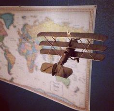 Explorer nursery, adventure theme, baby boy room, spray-painted gold airplanes flying by world map.