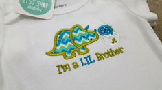 These adorable sibling dinosaurs will look so cute on your baby, toddler or big kid to celebrate their siblings! Works great as a pregnancy announcement, baby shower or baby birth gift! Embroidered SAMPLE SALE: Dinosaur Sibling, Sibling Gift Shirt, Big Little Brother or Sister, Pregnancy Announcement Baby Toddler Bodysuit