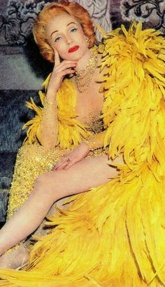 MARLENE DIETRICH 'How to be happy & glamorous at 55' Chicago Sunday SUN-TIMES cover (detail) August 2, 1959. Marlene in her $12,000 yellow feathered cape & sequinned gown. Knocking a few years off her age as well, but so fabulous. (please follow minkshmink on pinterest)