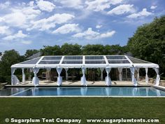 This clear-top tent has white taffeta pole drapes to complete the elegant look for this tented wedding.