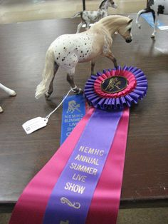 Crispie Honeysuckle Spot goes on to win a top ten at NEMHC.  Owned by Brenda Bednar.   Custom painted by #Arcadiancreations.