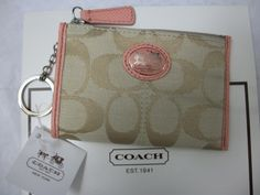 ' Coach mini skinny wallet khaki with coral accents' is going up for auction at  9pm Sat, Feb 23 with a starting bid of $30.