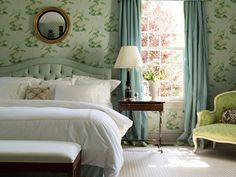 This elegant-yet-inviting Westport, Connecticut bedroom by Matthew Patrick Smyth makes use of soft shades of green and pink, as well as 18th-century antiques, at his client's behest.
