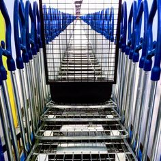#stacked #carts #shopping #ikea #blueandyellow #metal #shinny #designer #industrialdesign #interiordesign #perspective #perspective_junkie #perspective_in_focus #artinstallation #art_we_inspire #ottawashot #ottawaimage #pinecrestmall #texture #harmony_of_light by 7jdesign