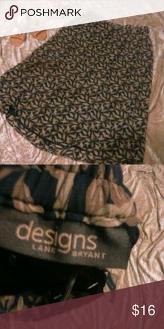Lane Bryant DESIGNS Women's Print Skirt SZ 18/20 Great skirt dark blue and tan leaf print side zippered hidden closure and fabric matching elastic waistband in back. Pre-loved but you may mistake it for new. Maxi length, fully lined in solid blue, machine wash Sized as a 2X = 18/20  Inv W1 Lane Bryant Skirts Maxi