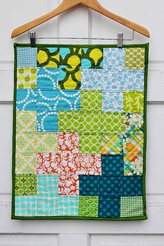 cute idea for hanging small quilts
