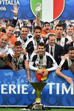 Juventus' players and staff celebrate with the trophy after winning the Italian Serie A football match Juventus vs Sampdoria on May 14, 2016 at the Juventus Stadium in Turin. .Juventus celebrate a record-equalling fifth consecutive Serie A title.  / AFP / GIUSEPPE CACACE