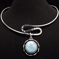 """Sterling Silver Larimar Pendant & Slider Pendant Stamped """"Sterling"""".  Authentic Larimar  Slider Stamped """"925""""  This is not a stock photo. The image is of the actual article that is being sold  Pendant Size: 1.2 inches diameter   Sterling silver is an alloy of silver containing 92.5% by mass of silver and 7.5% by mass of other metals, usually copper. The sterling silver standard has a minimum millesimal fineness of 925.  All my jewelry is solid sterling silver.   Hand crafted in Taxco…"""