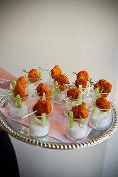 Buffalo chicken bit shooters with blue cheese dressing