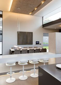 Located within the leafy suburb of Athol, Johannesburg, stands the latest contemporary stunner from Nico van der Meulen Architects. Designed by the highly acclaimed Werner van der Meulen, House Sar encapsulates luxury, comfort and functionality in a. Modern Kitchen Design, Modern House Design, Modern Interior Design, Home Design, Home Interior, Interior Architecture, White Bar Stools, Luxury Office, Design Blogs