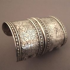 Silver, Central Asia   Description :   This ancient tribal cuff from Turkmenistan ( early 20th century) is a collector's piece : you can't find them easily of such quality anymore...the engravings and the patina are quite nice...  Weight:119,4gr www.halter-ethnic.com...