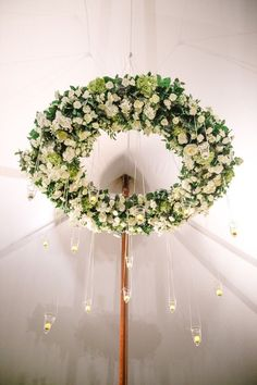Stunning floral wreath with hanging votives