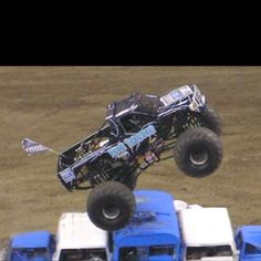 To drive a Monster truck over cars!
