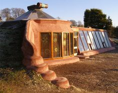 Earthship: completely sustainable home made from recycled materials like bottles, cans and old tires.