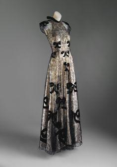 Designer- Madeleine Vionnet (French, Chilleurs-aux-Bois 1876–1975 Paris) Date- 1939 Culture- French Medium- cotton, metallic