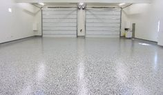 """This Epoxy Chip work is a high performance seamless floor made up of two part epoxy resins and colored acrylic chips.It is alsocoated with a high gloss abrasion and chemical resistant polyurethane. Because of the amazing durability and endless decorative applications, such as garage floors, patio decks, retail stores, office spaces, warehouses and more, this """"Granite Look"""" floor is a popular choice."""