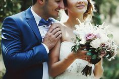 Beautiful couple of happy stylish newlyweds