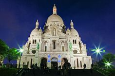 The Sacred Heart by night. Perched on a hill to the north of Paris, the basilica dominates the skyline of Montmartre with its white dome.