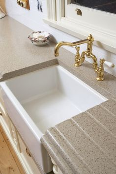 Charming Staron Solid Surface Countertop With Built In Drain Board Near The Sink.  Perfect For A Kitchen Renovation!