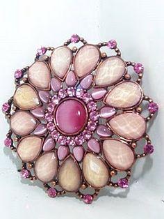 vintage brooch in rosy hues