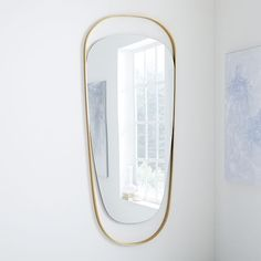 This celestial-inspired mirror appears to float within the smooth curves of its antique brass frame, for an airy piece that adds movement and light to rooms. Modern Floor Mirrors, Reclaimed Wood Floors, Traditional Artwork, Vintage Mirrors, Pedestal Dining Table, Modern Art Prints, Bedding Shop, Home Wall Art, Bath Accessories